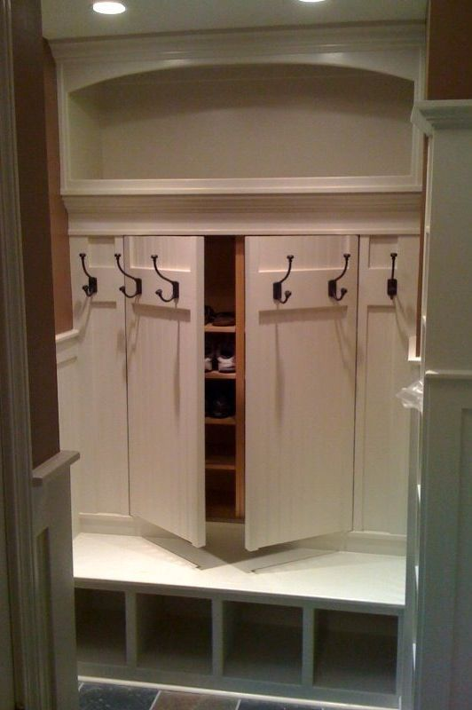 If you've got the room, here's a clever way to add hidden storage to your mudroom.