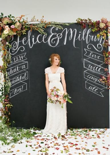 chalkboard backdrop + florals. But painted with gray chalk paint for a softer look.