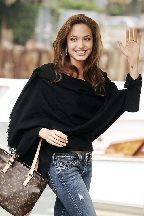Angelina Jolie makes it look so easy! A large scarf or poncho can turn any pair of jeans to lux