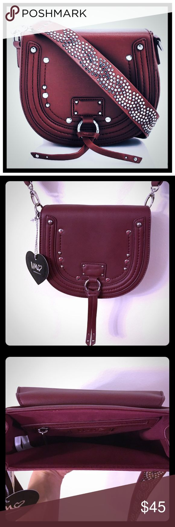 NWT Imoshion Studded Saddle Cross-body {wine} bag 📦Same day shipping (as long as P.O. is open for business). ❤ Measurements are approximate. Descriptions are accurate to the best of my knowledge.  Western meets downtown chic in this gorgeous wine-colored cross-body saddlebag. This structured bag features a flap with magnetic closure, Metal studs & tassel detail. A wide shoulder strap with intricate multicolored stud pattern. Ample main compartment with interior zipper pocket to secure…