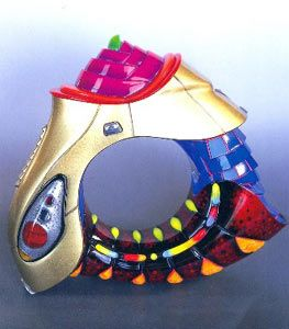 Although some of Chang's jewellery is fairly large, it is surprisingly light. The core of each bracelet is made from polyurethane foam carved to shape. Chang then encases this core in polyester resin, reinforced with glass fibre strands. He then applies acrylic and uses heat to mould it to shape. Several layers of resin might then be added and polished.