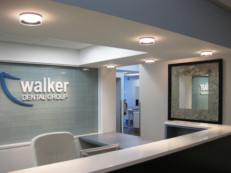 Prominent Logo Behind Reception Front Desk Inspiration