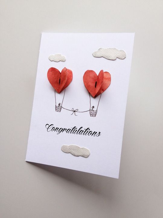 handmade wedding card with balloons floating among the clouds