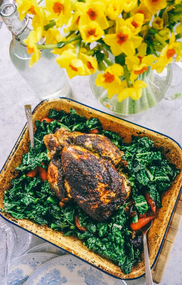 Cooked in a crust of green herbs, surrounded by a nest of carrots, kale, shallots and drizzled in its own gravy.