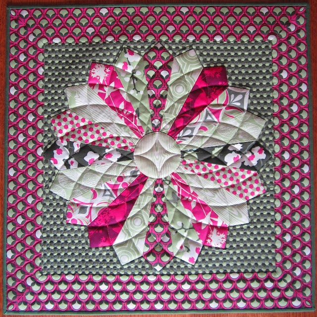Dresden block quilted like a Dahlia with beautiful results. Tutorial for the Dresden - link within this page, and also pinned on my Quilting Tutorials board