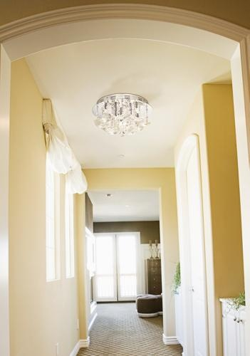 Sunny yellow hallway decorating idea.
