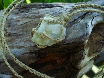 A lovely natural piece of hemp wrapped aquamarine.