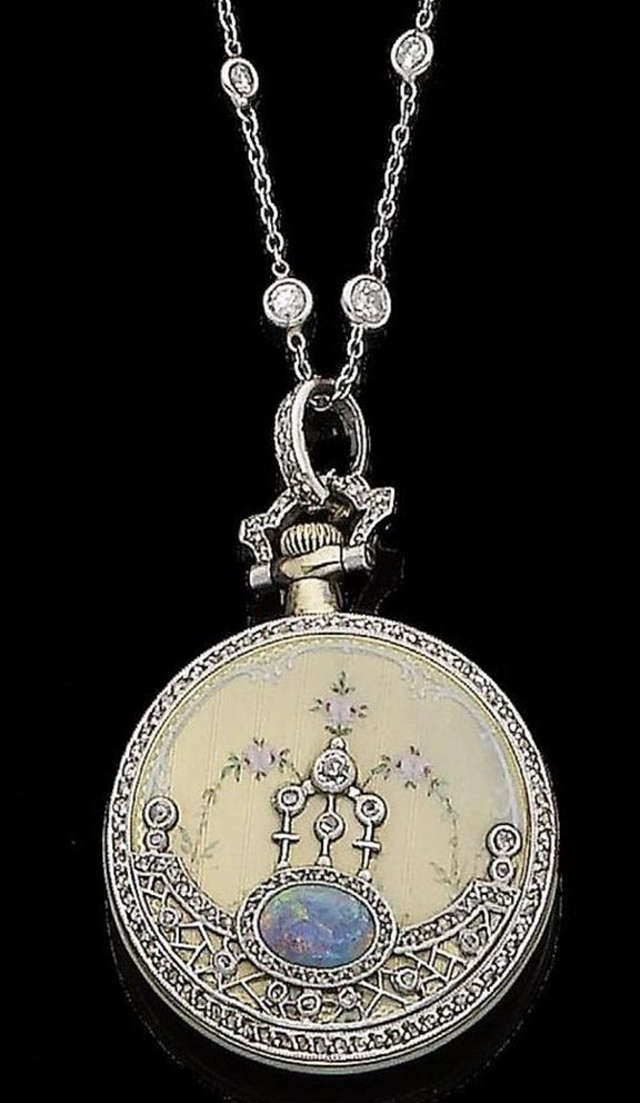 A belle époque opal, enamel and diamond fob watch, by Tiffany & Co., circa 1905. The circular dial with Roman numerals to a gold and green enamel bezel, the reverse decorated with polychrome floral enamel detailing, overlaid by rose-cut diamonds and an oval cabochon opal, to a spectacle-set old brilliant-cut diamond chain