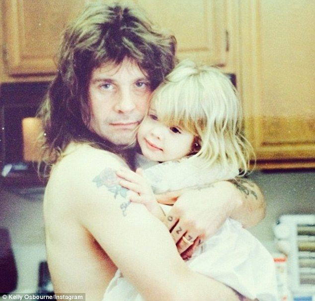 Ozzy Osbourne & daughter Kelly, not the finest quality photo, but great all the same! .Kelly is precious
