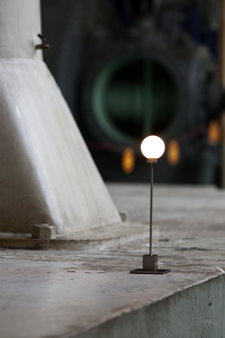 "Snowball is constructed in metal, with a ""snowball"" shape in frosted glass for a lampshade."