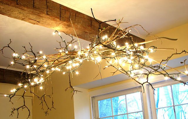 Sticks and Christmas lights for rustic chandelier @Alicia Splane for your rustic wedding