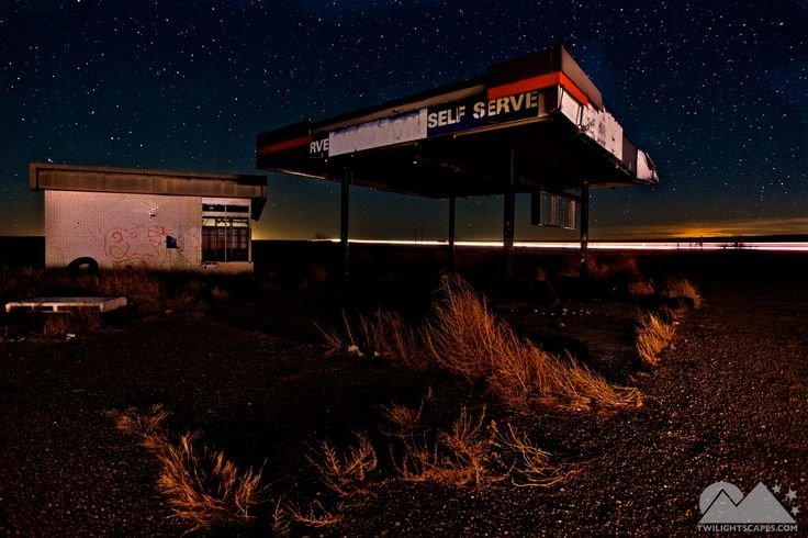 Night 101 An abandoned gas station on old Route 66 gets passed by nearby traffic on I-40 as if it's being passed by time.   View More: http://yearofnight.com/night-101/ Tags:  #Abandoned, #Asphalt, #Building, #Car, #CarTrails, #Concrete, #Desert, #GasStation, #GhostTown, #Glow, #Highway, #LightPainting, #NewMexico, #Road, #Twilightscapes, #Yearofnight
