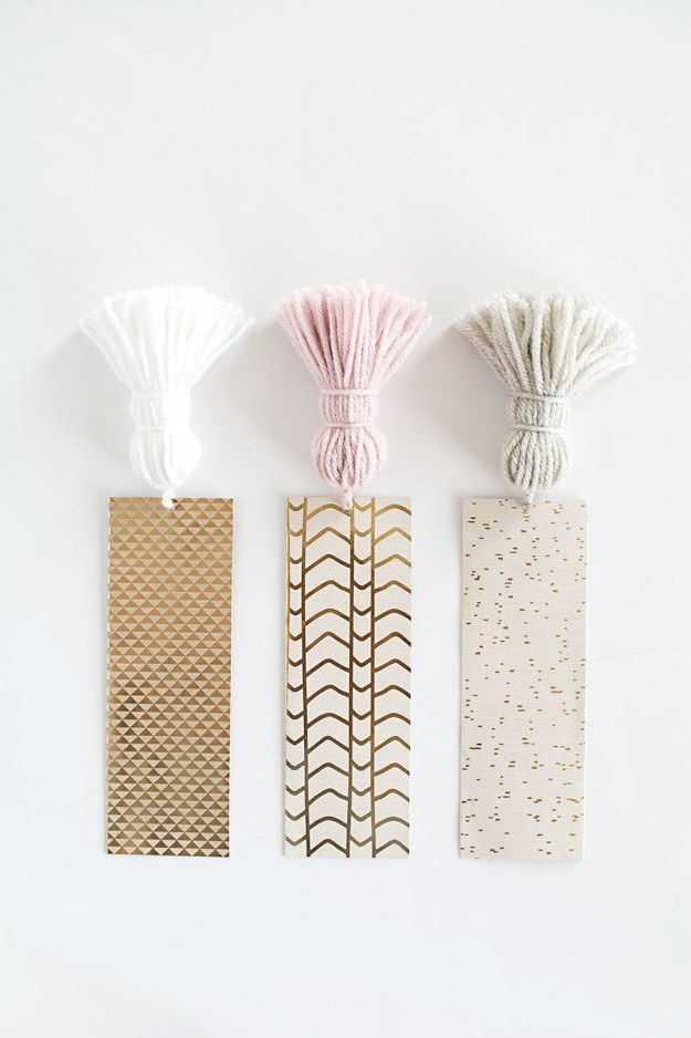 Slice up strips of pretty cardstock and add tassels to them for easy-to-grab bookmarks