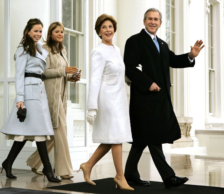 Fashionable family: President George W. Bush and first lady Laura Bush depart the North Portico of the White House for the limousine ride to the Capitol where he will take the Oath of Office and begin his second term on January 20, 2005. The couple is accompanied by their two daughters Barbara and Jenna, dressed just as elegantly as their mother and father. Photo Credit: J. Scott Applewhite, AP via @stylelist