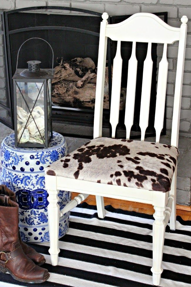Here are step by step directions to transform old gross dining room chairs. Loving the faux cow print fabric!