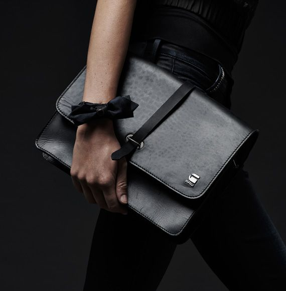G-Star RAW Midnight Collection Tip 9 - Leather At Night. Black is the colour of the night. Add a sleek, but practical note to your outfit with a simple shoulderbag in fine black leather with a refined version of a workwear clasp.