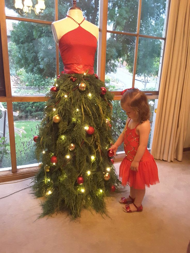 Christmas tree mannequin being admired by my granddaughter.