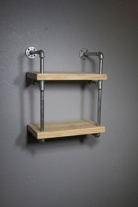 Our originally designed industrial pipe wall shelf, mini RAW is an exciting addition to an already inspiring line of custom shelving.     This unit is available AS SHOWN and is not customizable. It is sanded and ready for you to add your touches with stain, paint or even left unfinished. This uni...