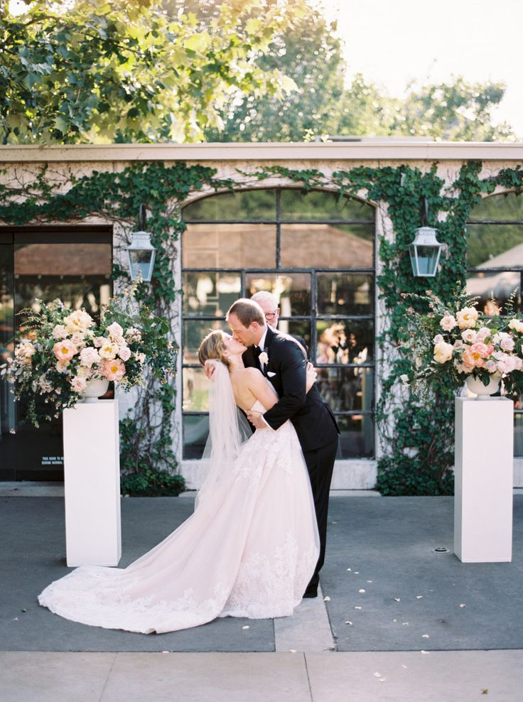 ceremony kiss - http://ruffledblog.com/chic-houston-garden-wedding