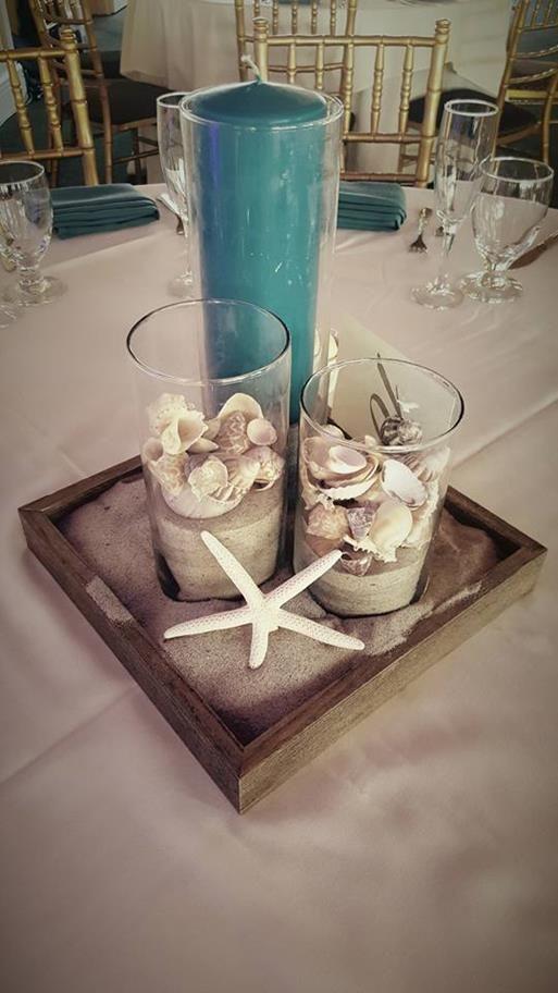 Simple but cute beach themed centerpiece| cylinder vases| beach shell and sand centerpiece| Tall candle centerpiece| Starfish centerpiece