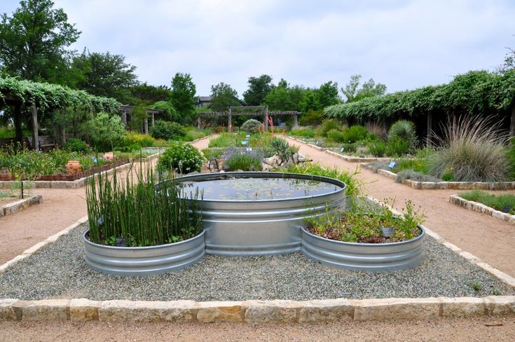 Think Outside The Box The Galvanized Animal Troughs Used As Planters Are Practical Decorative