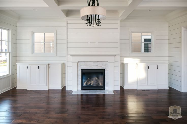 Love this marble and shiplap fireplace!