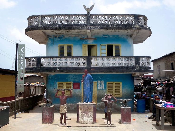 A statue of Supi Kwamina Essilfie stands in front of the Asafo company shrine or posuban at Elmina, Ghana. The Asafo were traditional warriors of the Akan ethnic group.