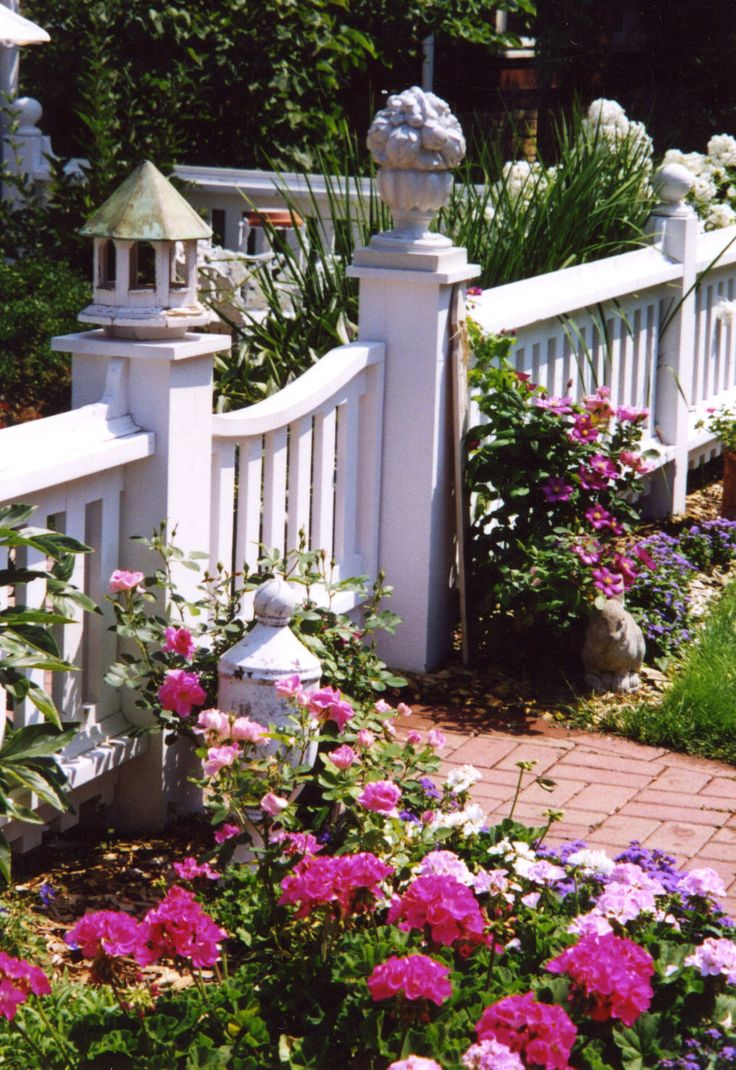 cottage fence and flowers, brick path, finials, birdhouse