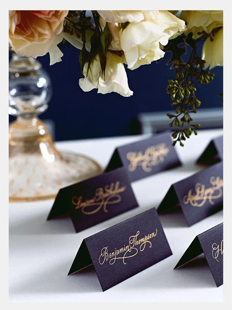 Black placecards with guests names in gold foil are so elegant and chic for a classic themed wedding!