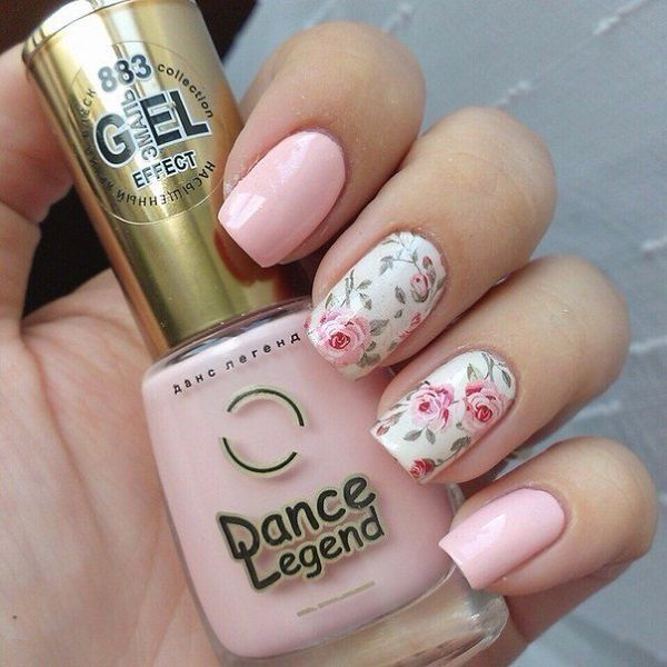 Simple and very pretty rose nail art design. The design looks very charming with the pink roses painted over the white nail polish as background. You can also see the light pink nails that have been painted to add variety to the design.