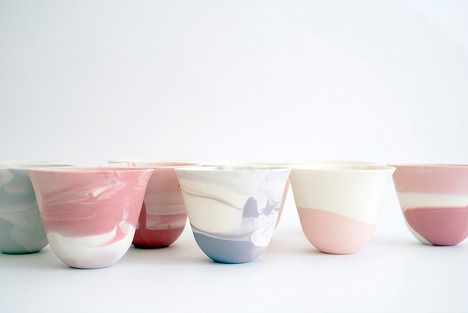 ceramic cups with a colourful swirl pattern created by using the slip-casting method and mixing different coloured slip.