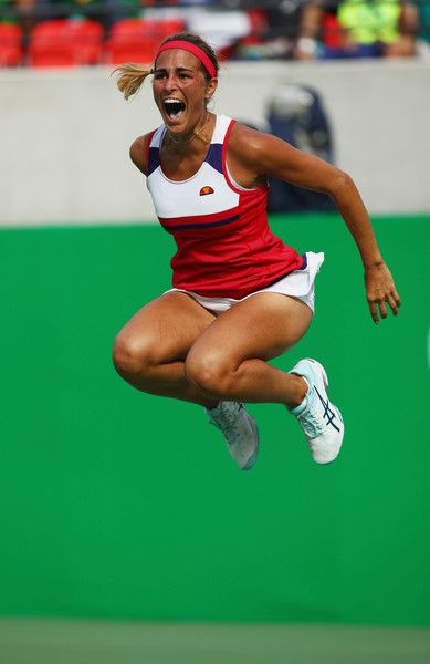 Monica Puig Photos - Monica Puig of Puerto Rico celebrates after defeating Petra Kvitova of the Czech Republic during the Women's Singles Semifinal on Day 7 of the Rio 2016 Olympic Games at the Olympic Tennis Centre on August 12, 2016 in Rio de Janeiro, Brazil. - Tennis - Olympics: Day 7