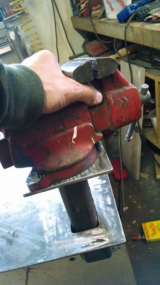 Removable vise for welding table, drops into a receiver like a truck hitch.