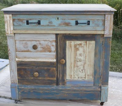 Old dresser rescued by Amy of The Salvage Collection with five colors of chalk paint.