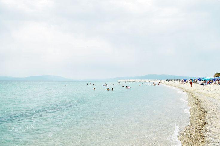 Life's a beach by ioanna papanikolaou - Summer scene in Ofrinio beach, Greece.