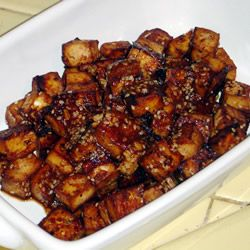 "Baked Tofu Bites | ""Tofu cubes are marinated in soy sauce, maple syrup, ketchup, vinegar, and seasonings, and then baked in the oven. The tofu can be used as a hot or cold snack or as a salad topping."""