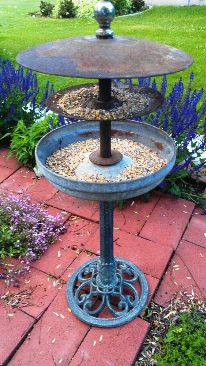 """ReInvented Bird feeder from bird bath, tractor discs, chicken feeder and trailer ball! 17"""" wide x 42"""" tall."""