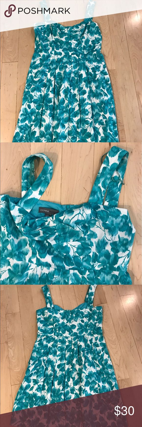 Donna Ricco teal floral dress size 14 Donna Ricco floral teal sundress in size 14. Lined. Back zip. Bust: 44 inches. Waist: 35 inches. Length: 40 inches. Donna Ricco Dresses Midi