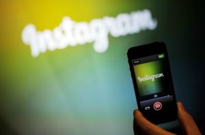An Instagram employee displays Instagram's new video function at Facebook's corporate headquarters during a media event in Menlo Park, California on June 20, 2013. (Photo by: Josh Edelson/AFP/Getty Images)