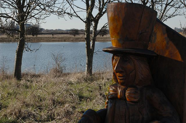 Mad hatter wooden statue woodland lake