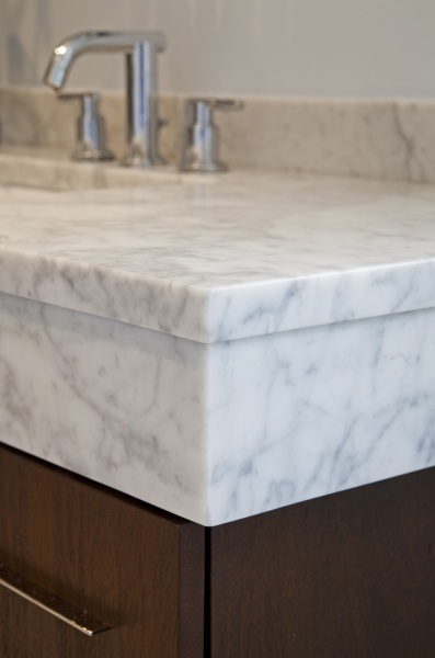 A Honed White Carrara Marble Top With A Drop Skirt Was