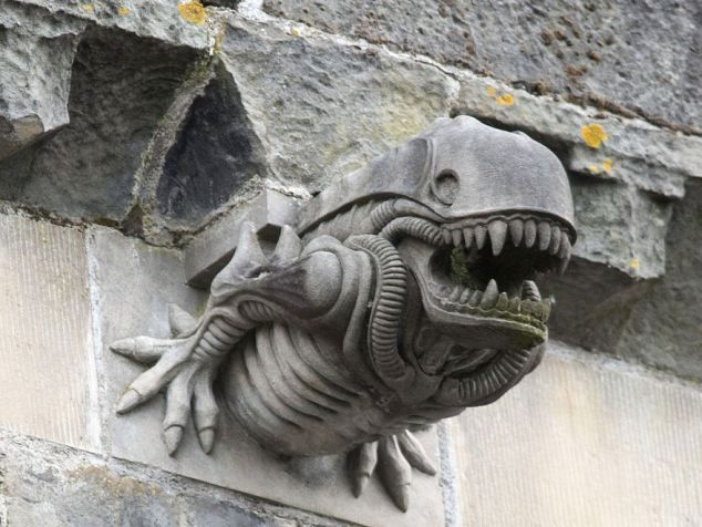 """A gargoyle on the outside a 13th century Scottish cathedral - Paisley Abbey - resembles an alien from """"Aliens"""" movie."""