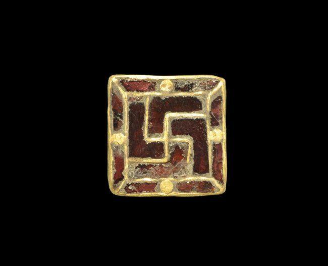 Merovingian Gold and Garnet Swastika Brooch, 5th-6th century A.D.