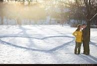 heart in snow - engagement photos in winter