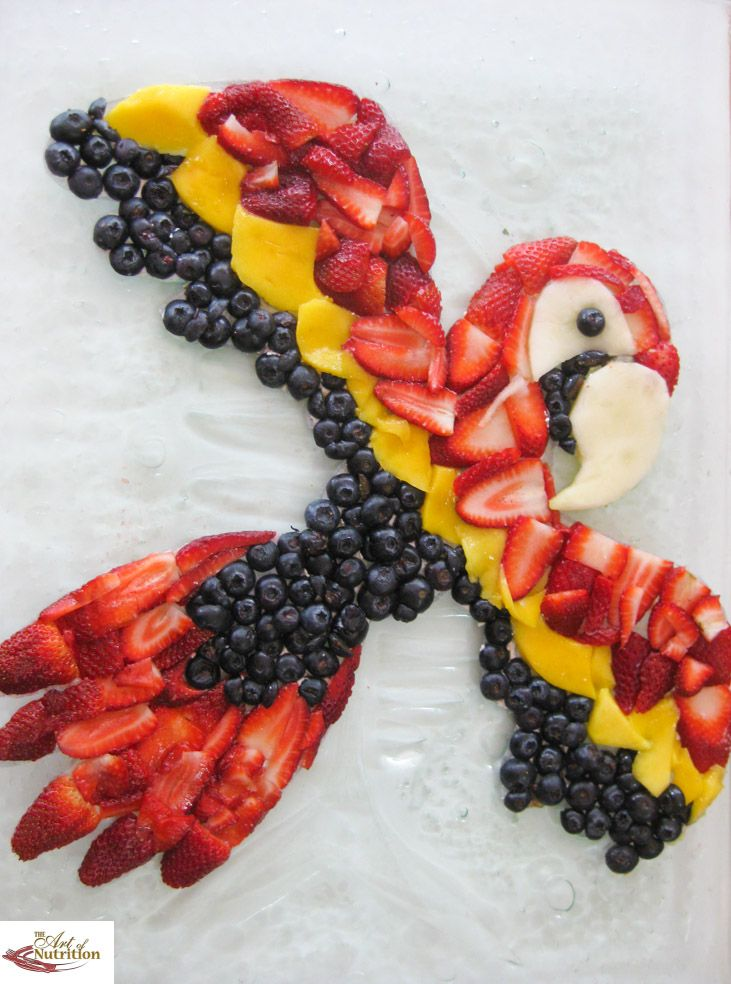 Colorful Fruit Parrot- Many different ideas for healthy fun food for kids on this pin encouraging healthy eating in children.