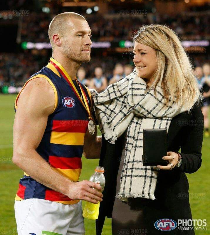 Phil's daughter, Quinn Walsh presenting Scott Thompson with the once only Phil Walsh medal fir best on ground.