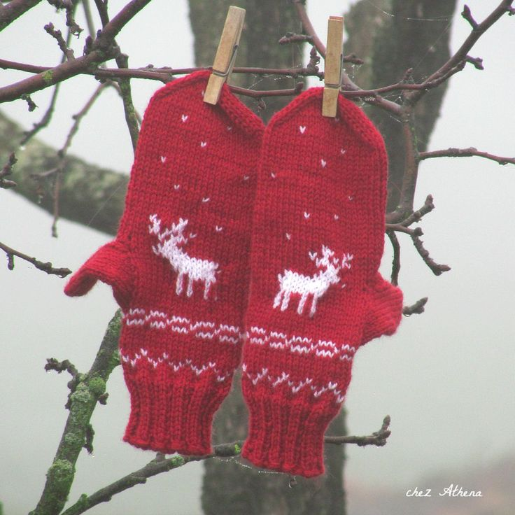 Knitted red mittens with white application (deers)