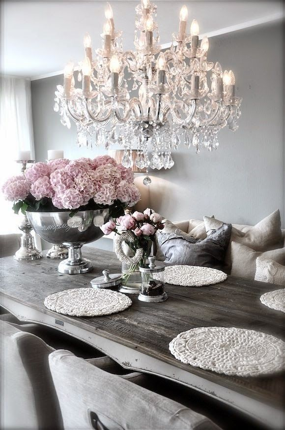 This table and the Flowers are a must! (Dining Room) With different place mats and chairs.