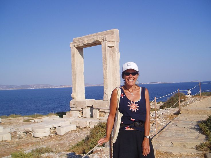 Colleen in front of the unfinished Apollo temple known as Portara.  It is a signature landmark of Naxos located on the tiny spit of land known as Palatia.