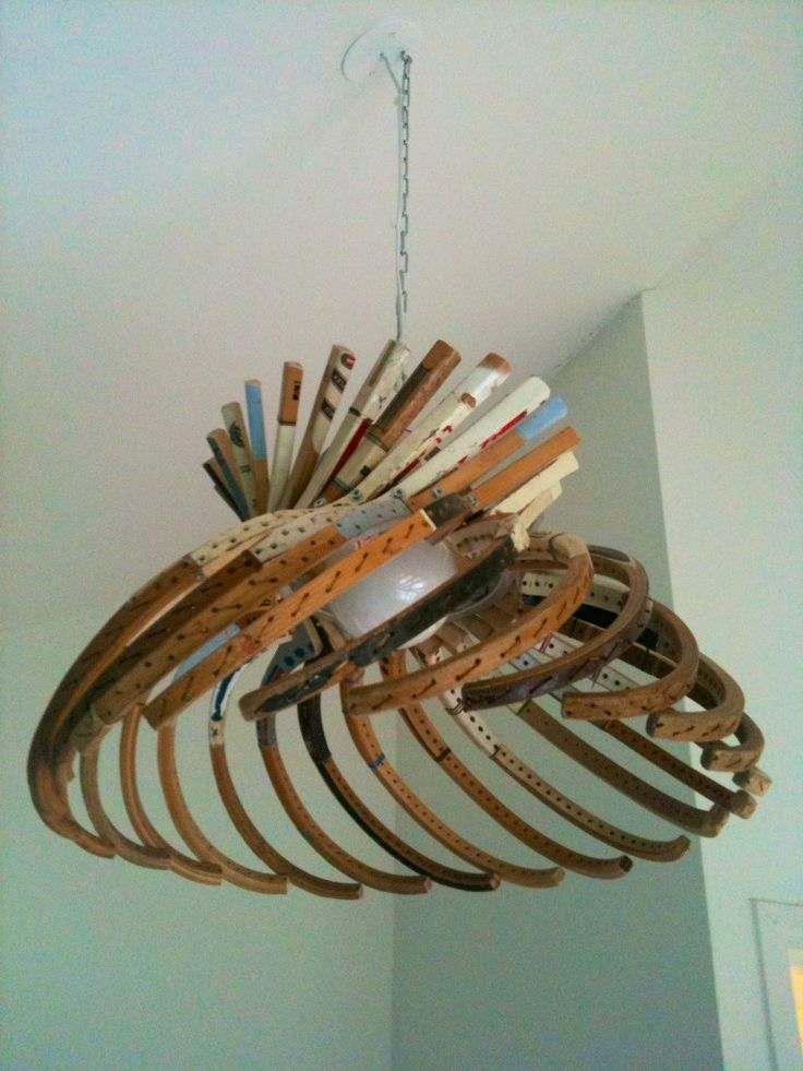 Lamp made out of wooden tennis rackets. Econexishuis Zwolle.
